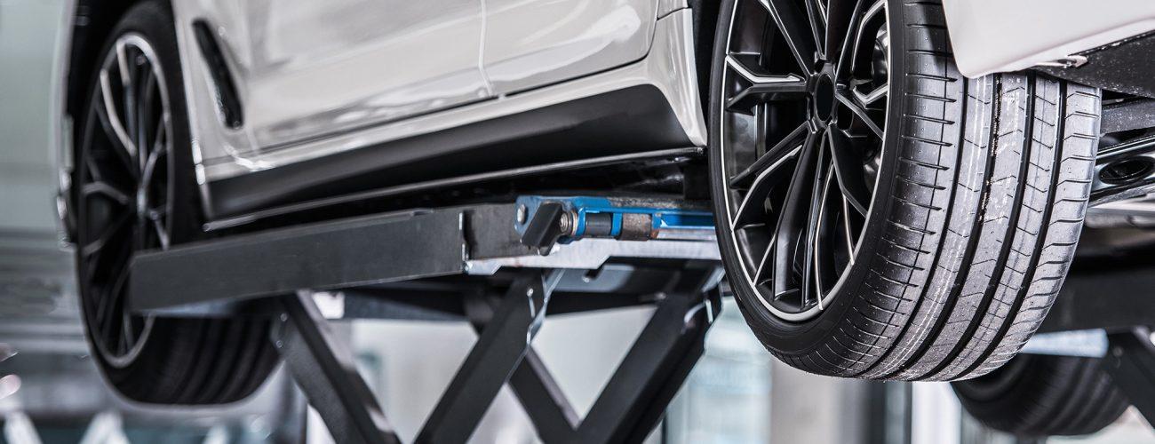 Car Repair on a Lift. Vehicle Maintenance. Automotive Technologies.